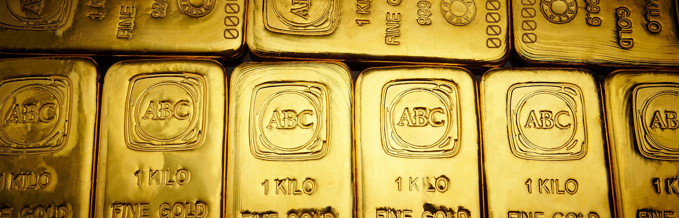 ABC Bullion 1 kilogram gold cast bars layed out next to one another