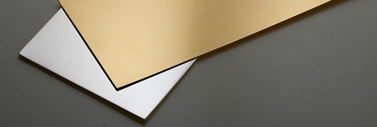 Fabricated gold and silver alloy sheets positioned on top of one another